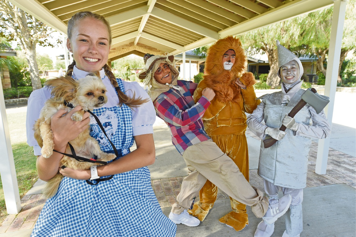 Taylah Geling  as Dorothy,holding a windswept Toto, with James Catatore (Scarecrow), Brian Davies (Cowardly Lion), and Alexei Chalk (Tin Man). Picture: Jon Hewson www.communitypix.com.au   d465621