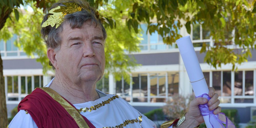 A man dressed as a Roman emperor disrupts a press conference by WA Premier Colin Barnett. Photo: AAP
