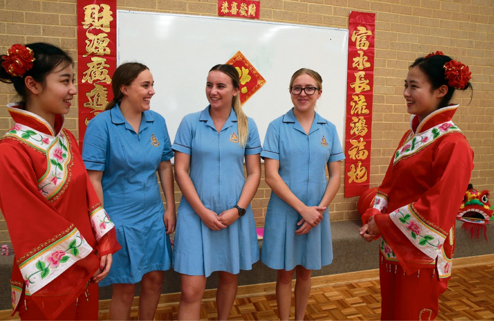 Yang Wenjing and Yu Yue'er from Wenqin Art Troupe from Zhejiang University in China with Jessie Barnes, Abbey Evans and Michelle Waller. Picture: Martin Kennealey d465272