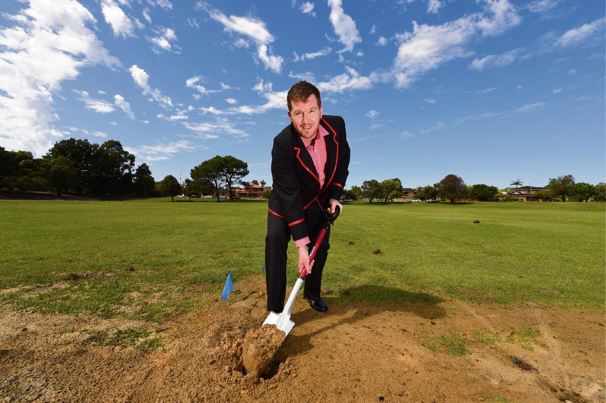 Applecross Cricket Club president Ryan Carmody turns the sod on his club¿s new turf wicket.