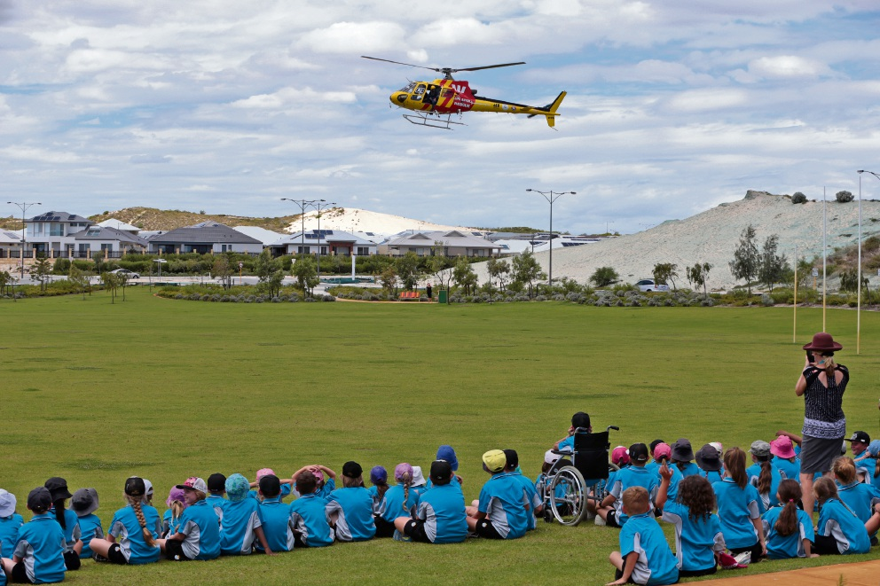 Alkimos Beach Primary students await the rescue helicopter. Picture: Martin Kennealey d465363