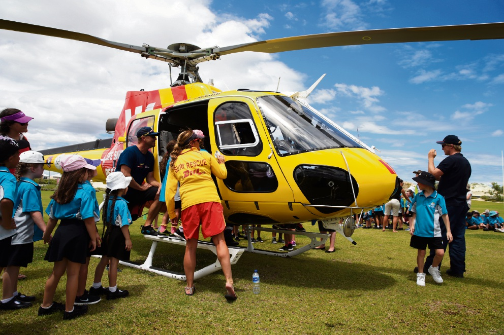 Excited Alkimos Beach Primary students inspect the rescue helicopter. Picture: Martin Kennealey d465363