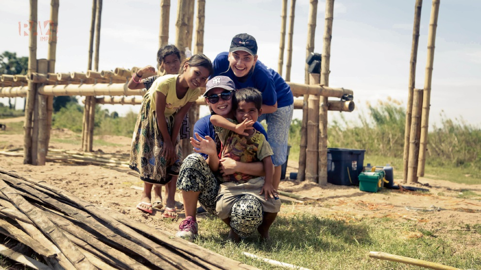 Students Megan Neville and April Choi with children from a Cambodian village. Picture: RAW Impact