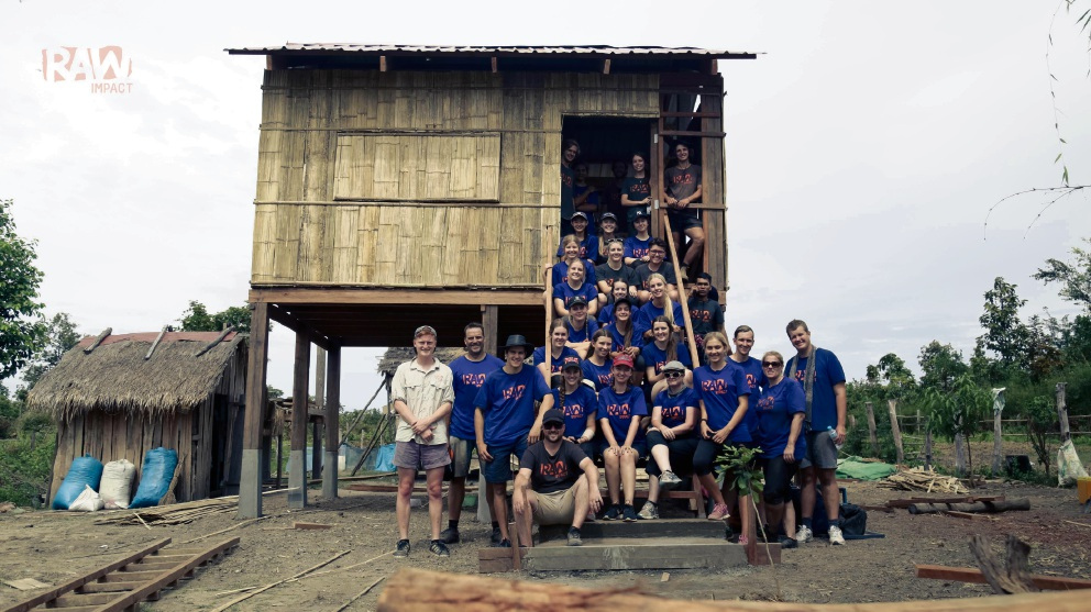 The team on the steps of the newly built house. Picture: RAW Impact