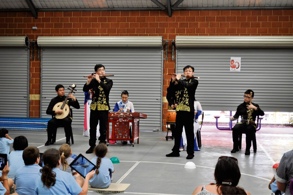 Wenqin performers entertain the school community.