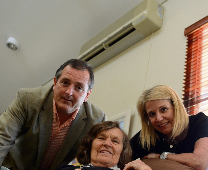 Shine chair Andrew Cuthbertson, Mosman Park client Jean Page and carer Liz Nicholas under the air conditioning to be replaced by the Lotterywest grant.