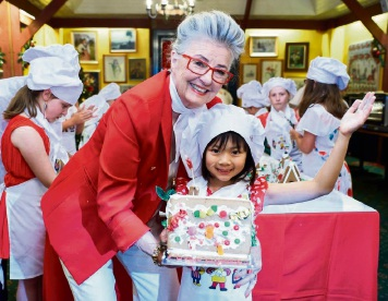 464098pd Aleisha Loh (8), of Waterford, displays her gingerbread house made with help from Maud Edmiston (Miss Maud) and her pastry chefs. Picture: Jeff Atkinson