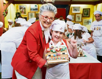 464098pq Victoria Hill (9), of Kingsley, gets a lesson from Maud Edmiston (Miss Maud). Picture: Jeff Atkinson