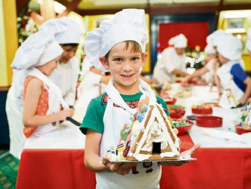 464098pe Christopher Toneman (6), of Woodvale, with his gingerbread house. Picture: Jeff Atkinson