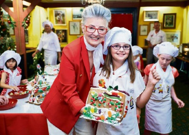 464098pi Elsie Casie (6), of Palmyra, gives a thumbs up to gingerbread making with Maud Edmiston (Miss Maud). Picture: Jeff Atkinson