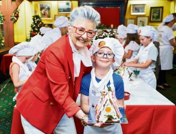 464098pk Beau Mittler (6), of Morley, took his baking with Maud Edmiston (Miss Maud) very seriously. Picture: Jeff Atkinson
