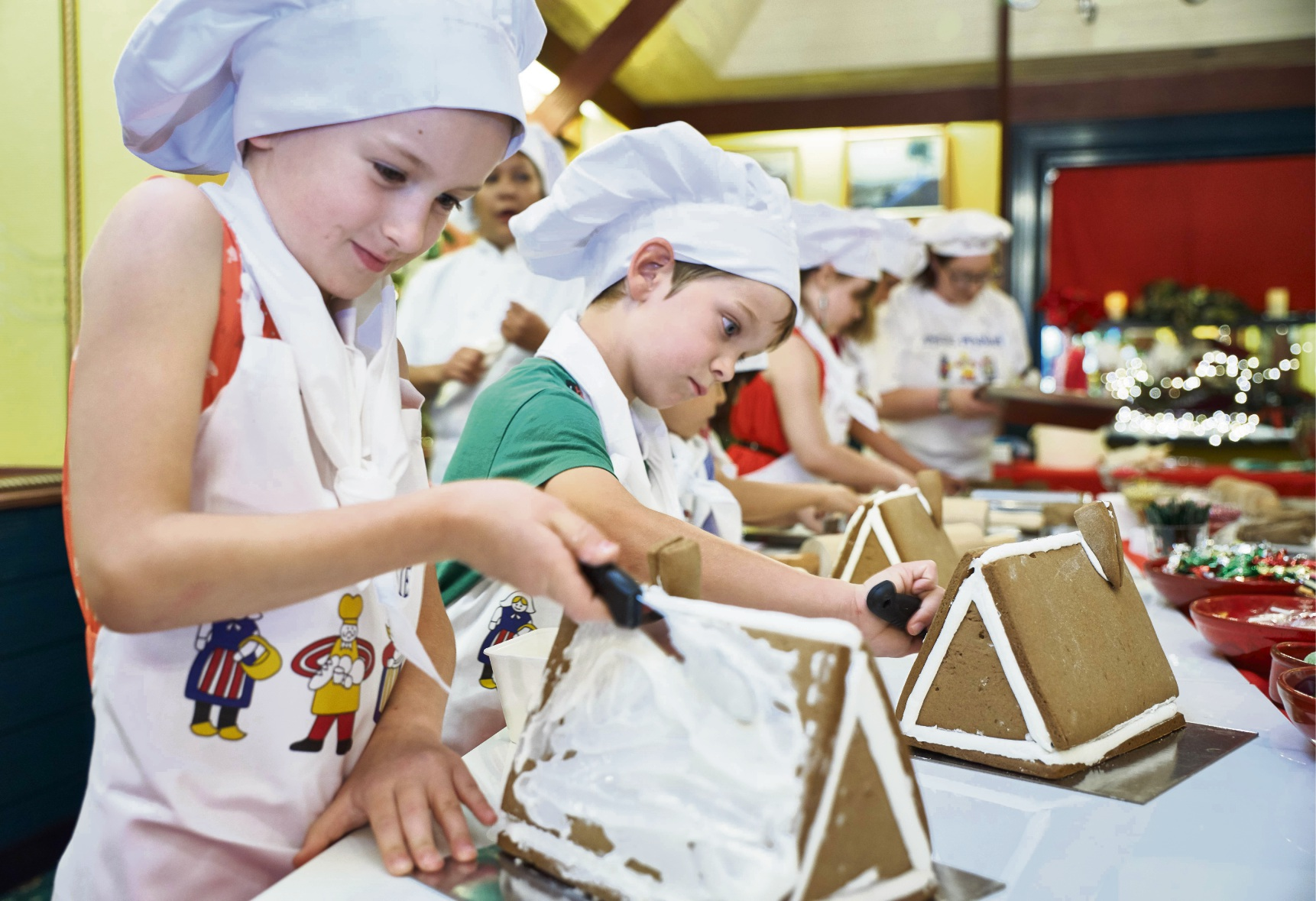 Children create Swedish gingerbread houses with Miss Maud for Christmas