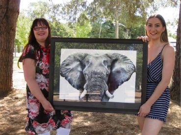 Darlington Arts Festival Youth Art Co-ordinator Megan Fraser with Sally Croft and her winning portrait of an elephant.