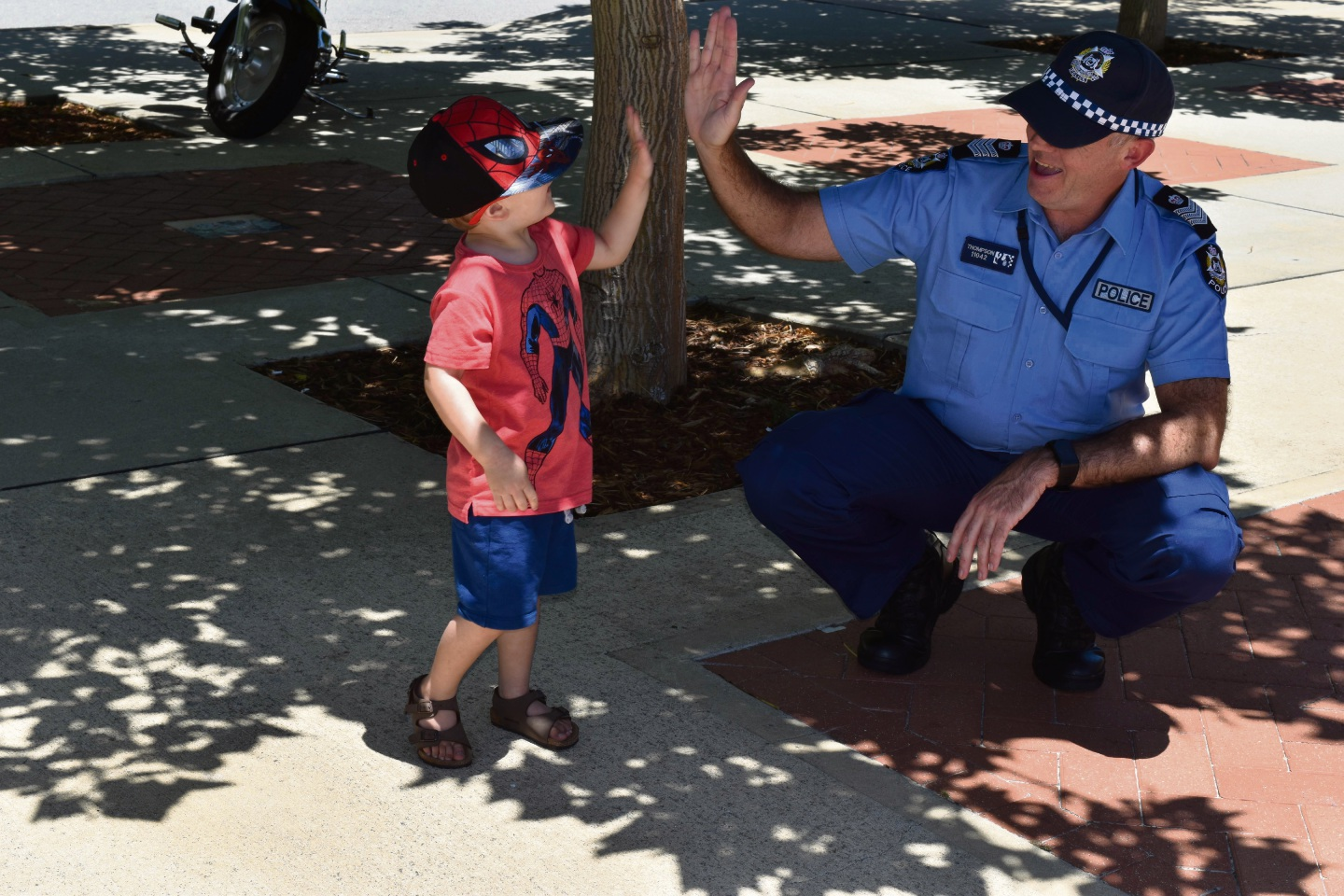 Mandurah officer in charge Senior Sergeant Stephen Thompson and Jacob (3) who will be enjoying some of the family friendly festivities this year.