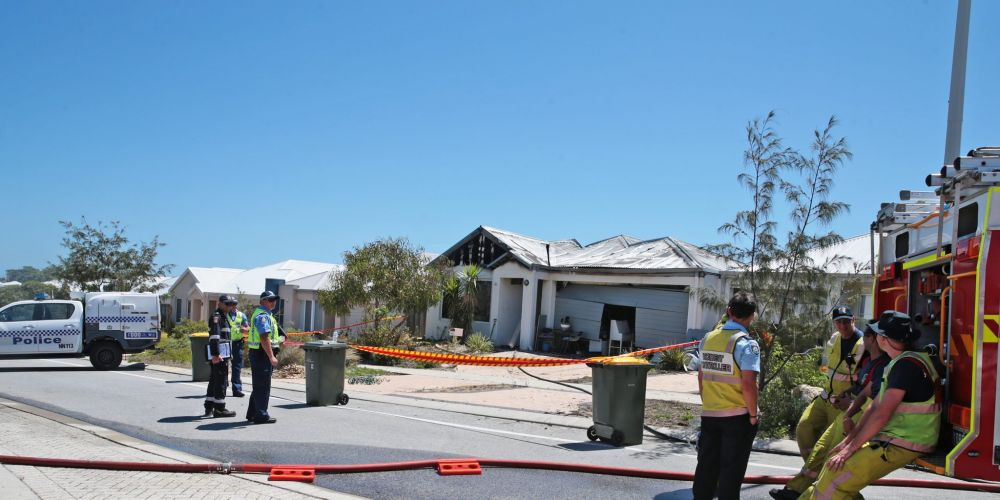 Emergency services investigate the cause of a house fire on Zamia Rise, Yanchep. Picture: Martin Kennealey d466223