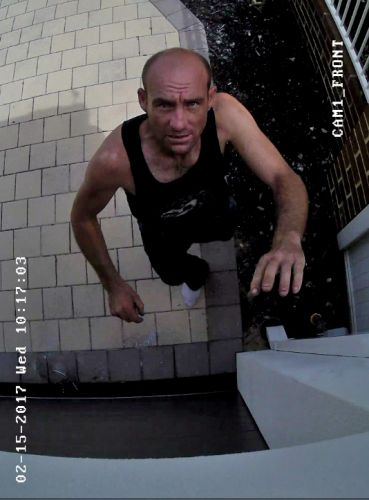A home security camera focuses on the suspect.