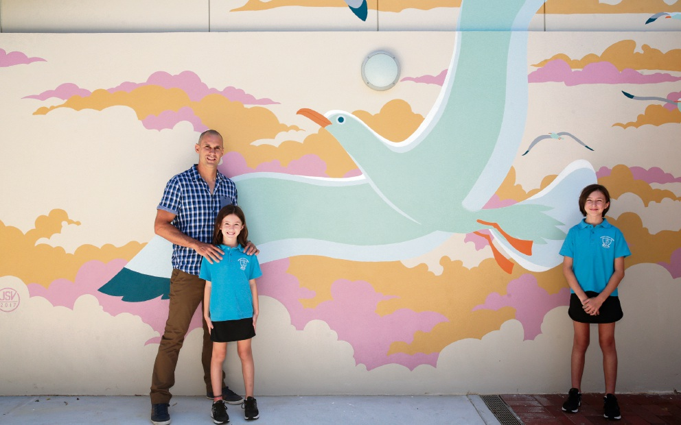 Mural artist Jose Saracho with his daughters Cristina (Year 3) and Lucia (Year 5).