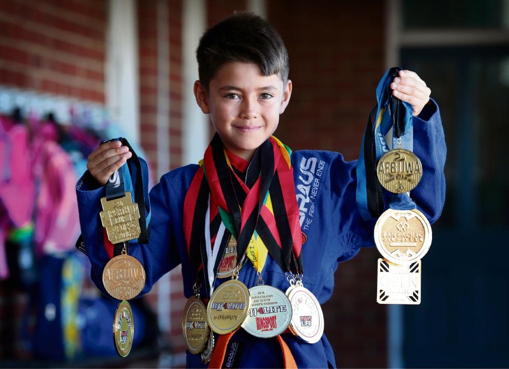 Medals galore: Young jiu-jitsu fighter Torez Carro.  Picture: David Baylis     d466068