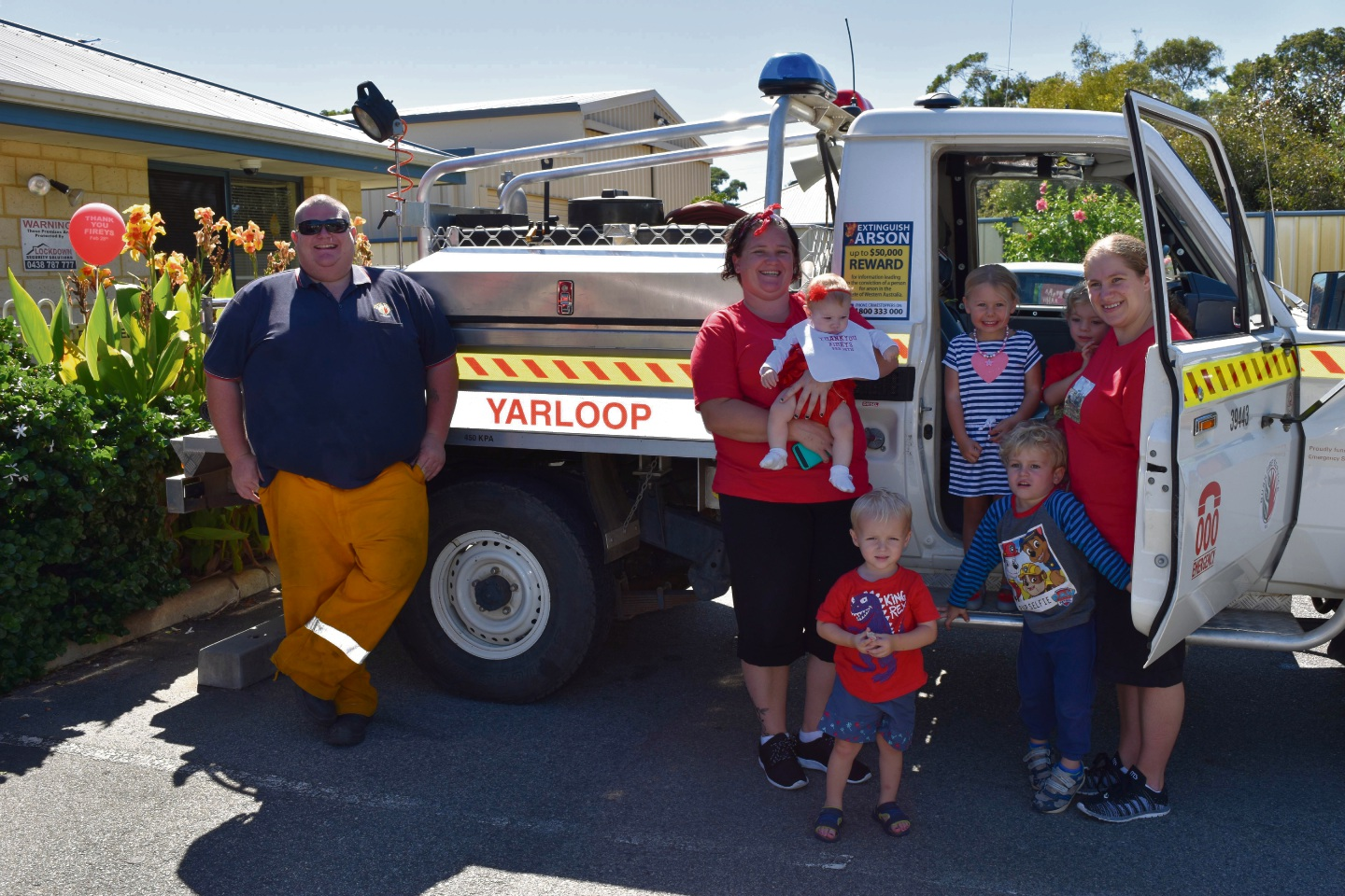 Above: Some children and their mums get up close to a fire truck. Below: Parents and their kids from Ravenswood Early Learning raising funds for Yarloop Fire Station.
