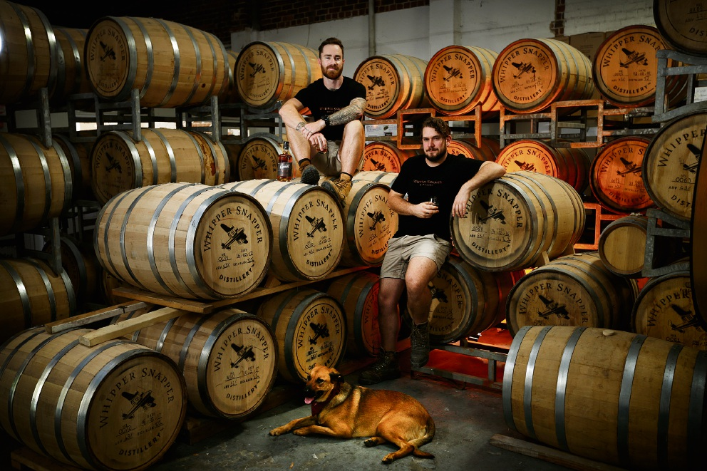 Whipper Snapper Distillery founder Jimmy McKeown and distiller Tim Hosken pause for a rest with Copper. Picture: Andrew Ritchie        d466159
