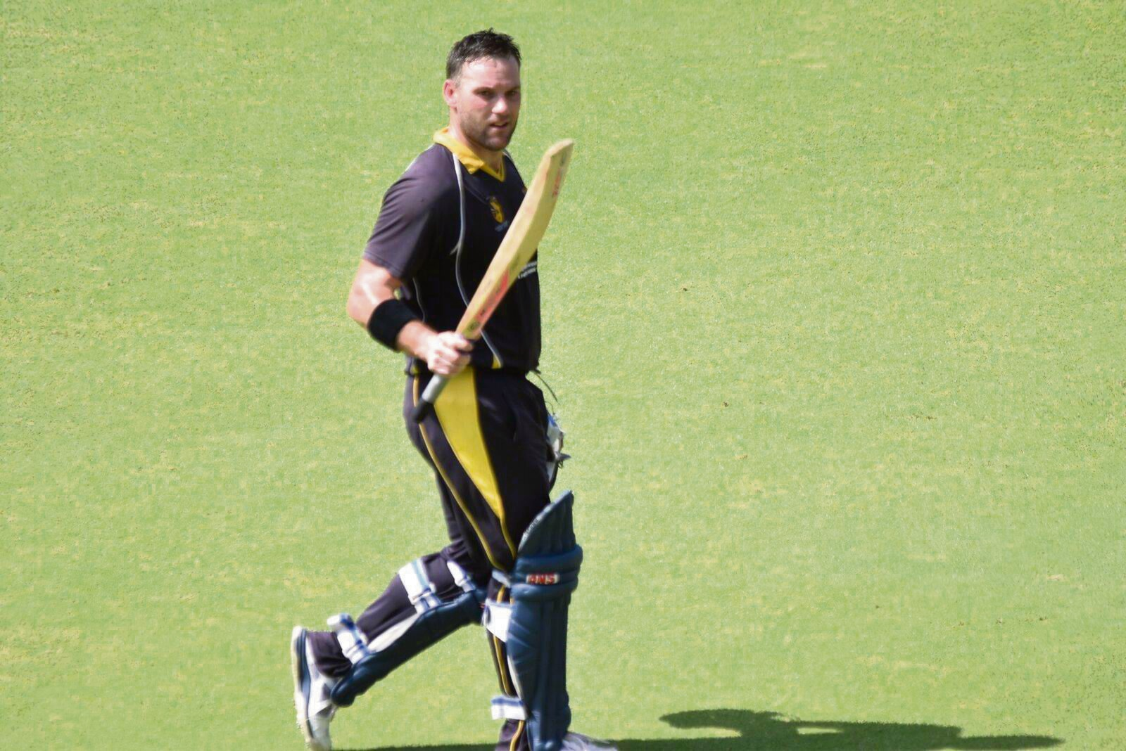 Travis Birt raises the bat after being dismissed for 149 in Claremont-Nedlands' massive win over Fremantle in the One-Day League grand finalat the WACA on Sunday.