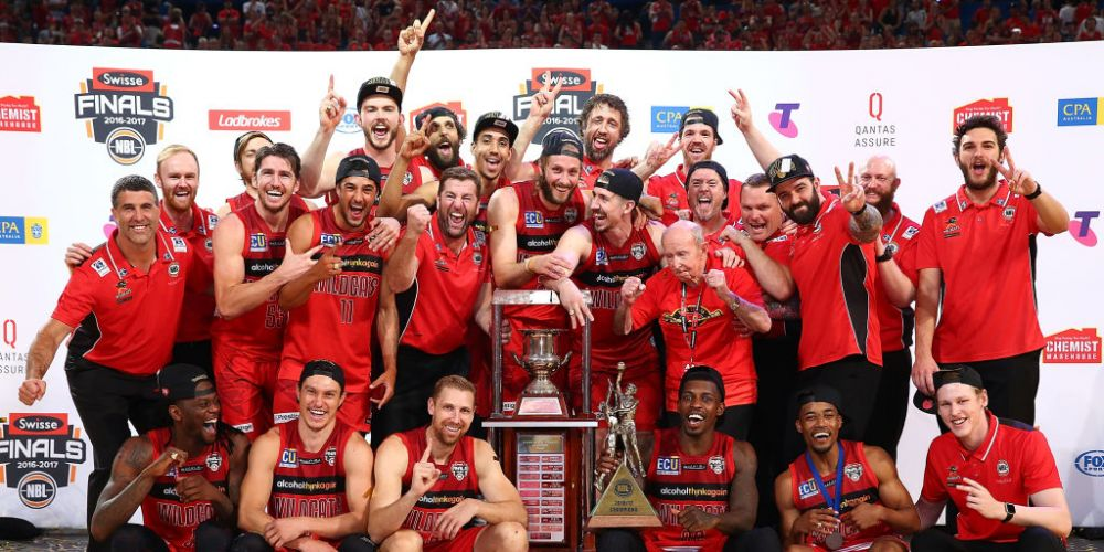 The Wildcats celebrate with the championship trophy after winning game three and the NBL Grand Final series. The Wildcats begins their 2017-18 NBL season with a home game against Brisbane on October 7. Picture: Paul Kane/Getty Images