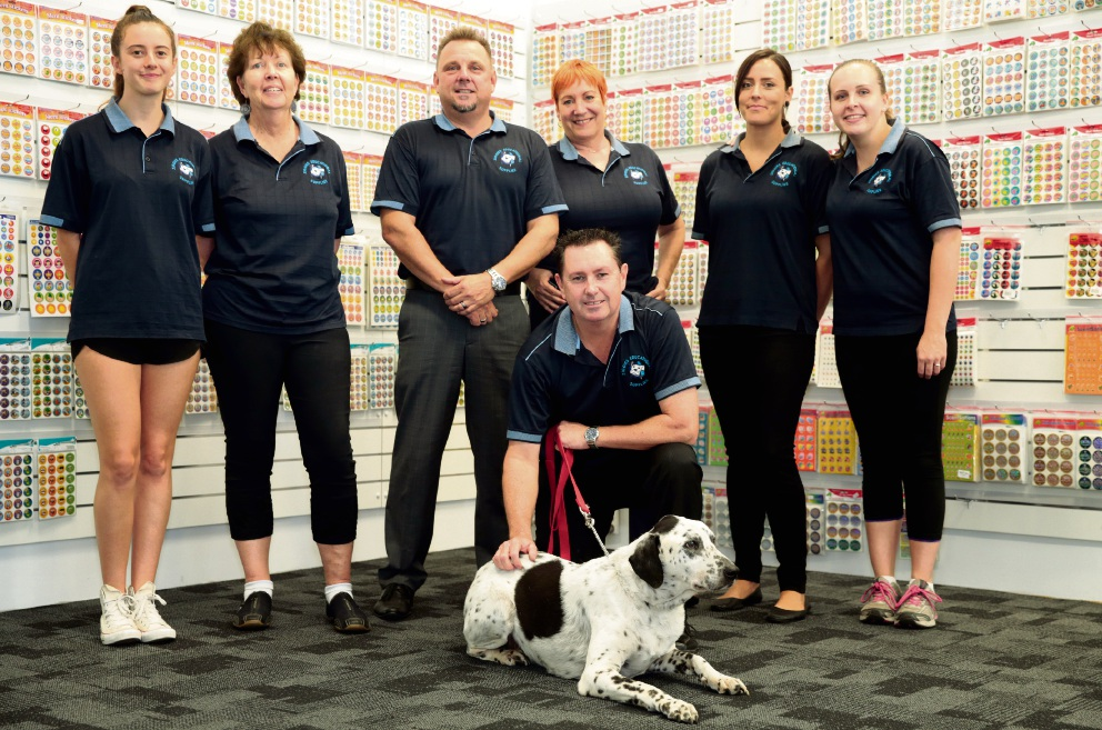 Andrew Durnin and Ziggy with Ziggies Educational Supplies staff. Picture: Martin Kennealey d465365