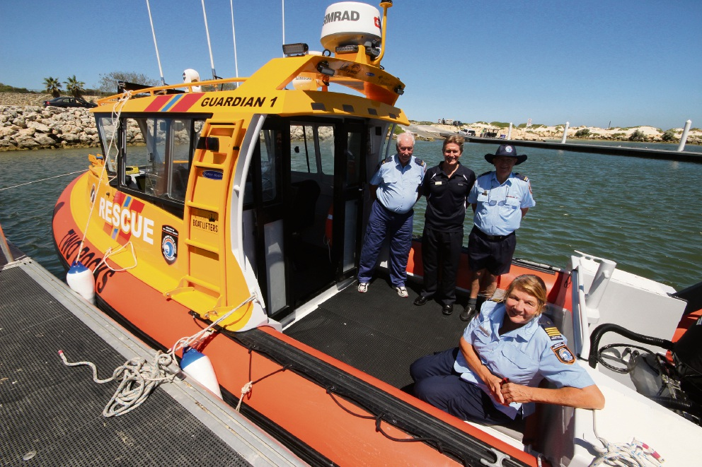 Two Rocks Volunteer Marine Rescue Group commander Pam Annesley (front) with John Chapman, DFES Assistant Commissioner Gary Gifford and Jim Smith.