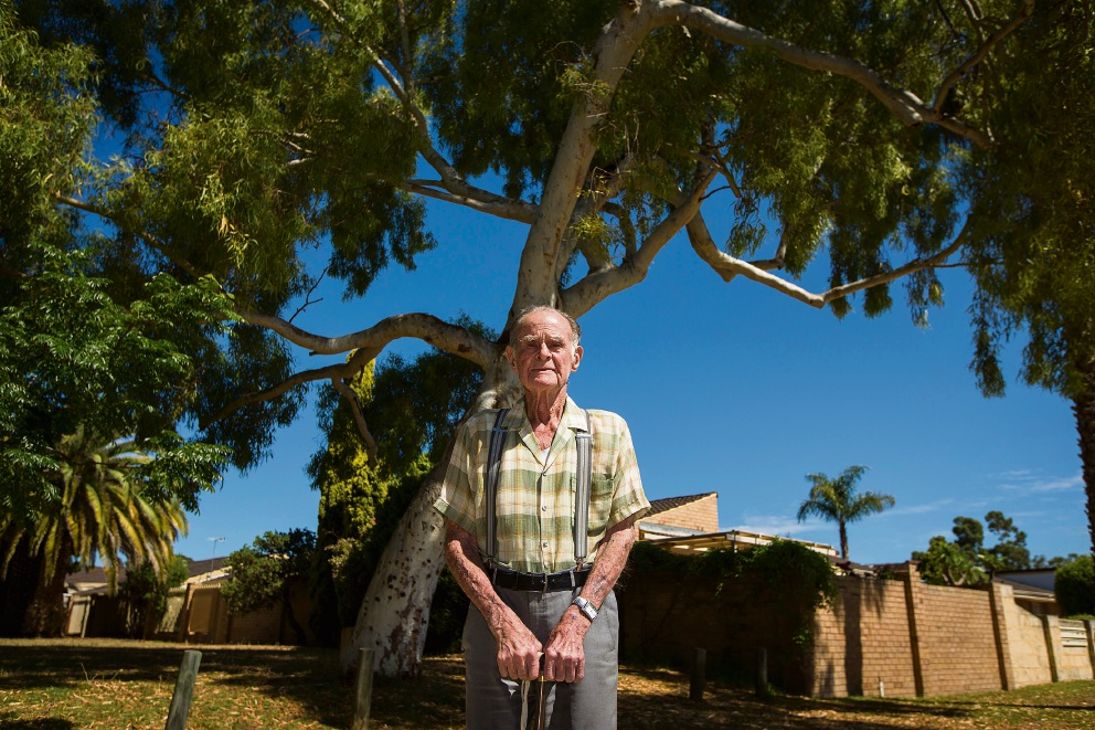 Charles Thorn and the tree at the front of his unit. Picture: Will Russell