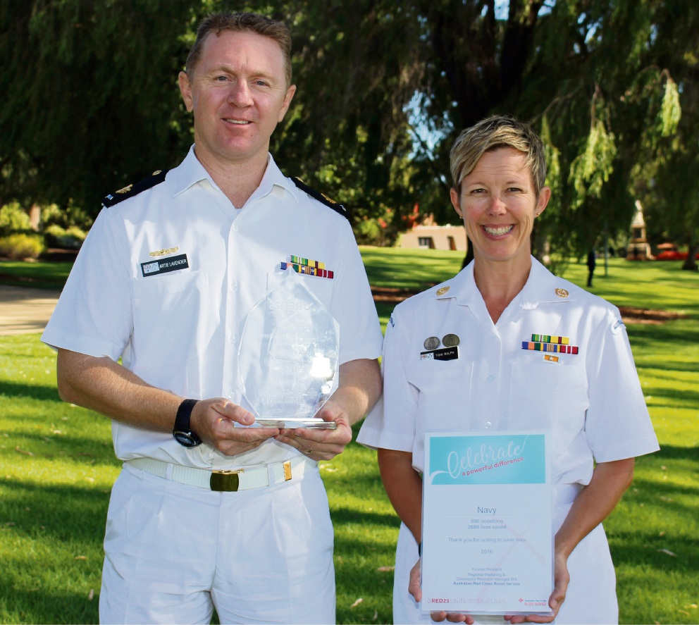 Warrant officer Artie Lavender and chief petty officer Toni Ralph with the award acknowledging the navy's contribution to donating blood.