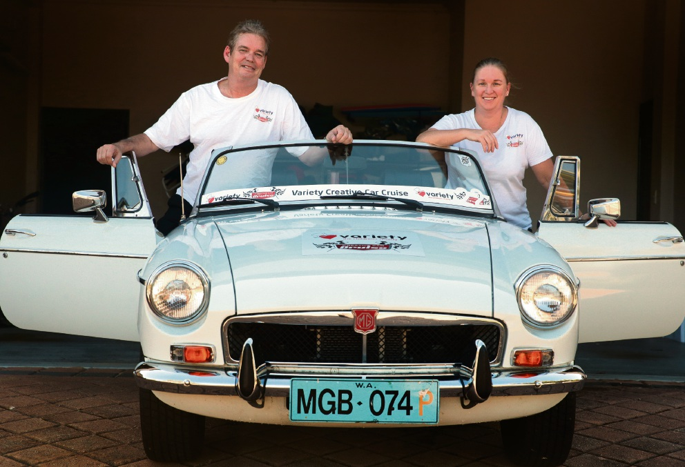 Lloyd Whitlock and Kellie Wild are driving this 'beaut' 1974 MGB on the Variety Creative Car Cruise. Picture: Martin Kennealey        www.communitypix.com.au   d466333