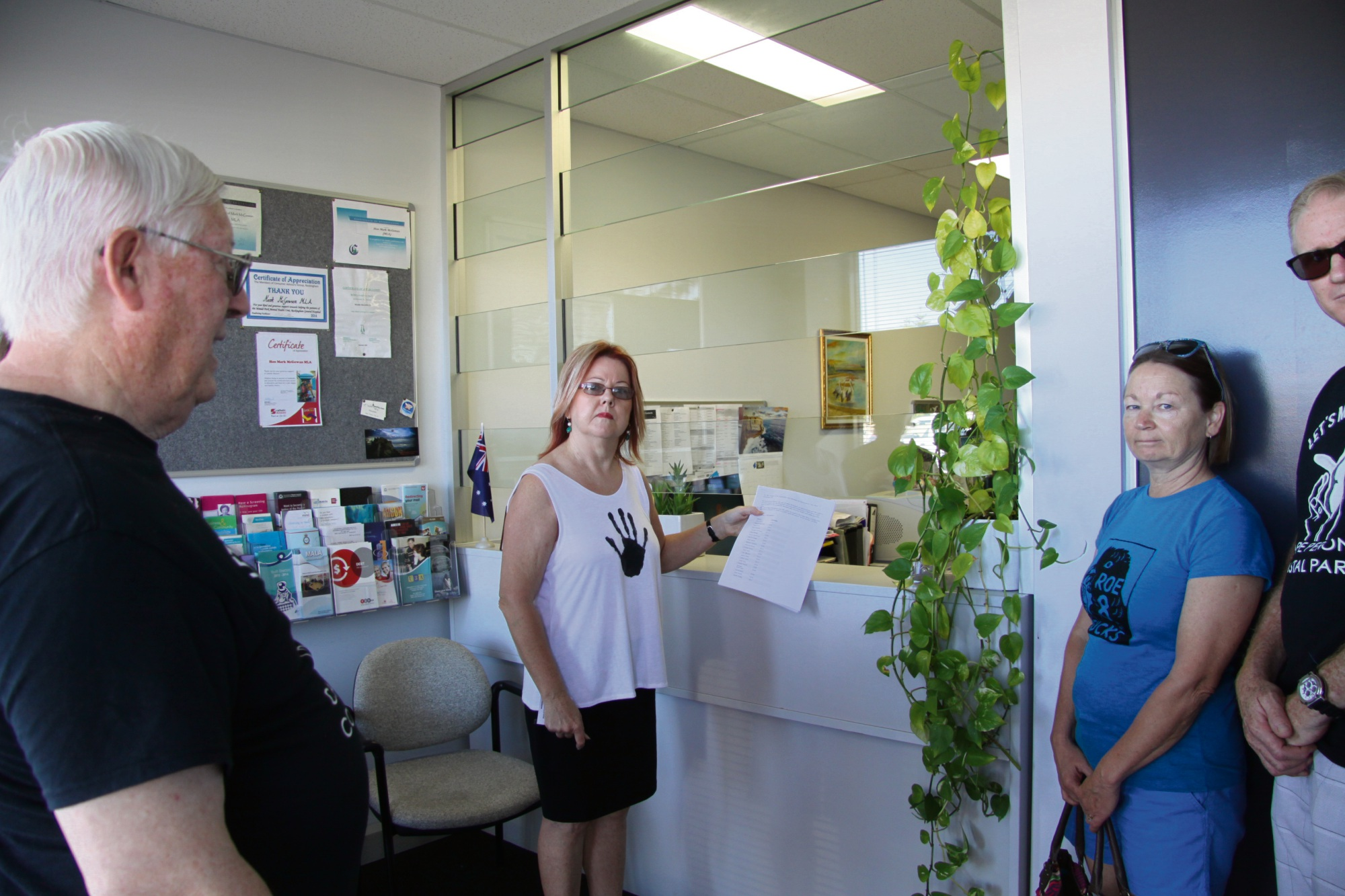 Dawn Jecks hands over the petition at Mr McGowan's Rockingham electoral office.