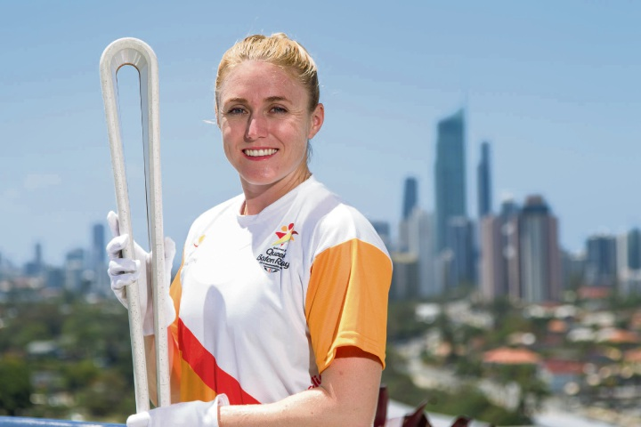 GC2018 Ambassador Sally Pearson with the Queen's Baton.