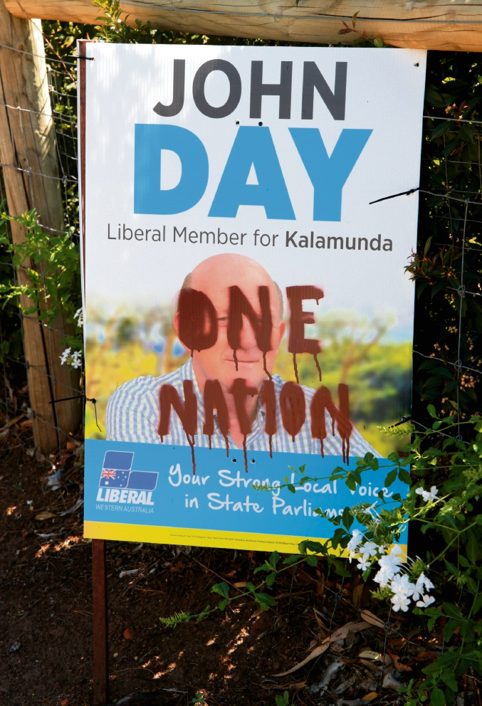 One of John Day's defaced election posters. |Picture: David Baylis                  d466371