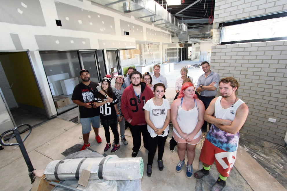Youths from the Swan City Youth Centre, Lotterywest representatives and a City of Swan project manager Neil Brown at the new hub.