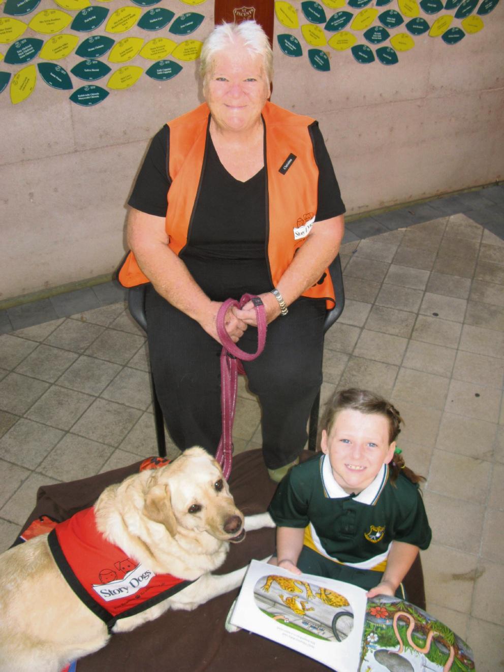Volunteer Christina Macaulay with St Vincent's Catholic Primary School student Taylor Javanovic and labrador Jasmine.
