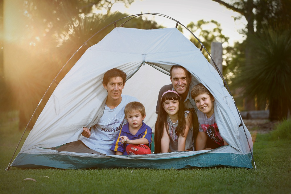 Declan Hanley with son Toby Stephenson-Hanley (5) and Rob Butler with Abbey (9) and Will Butler (11) prepare for the annual camp-out. Picture: Andrew Ritchie        d466553