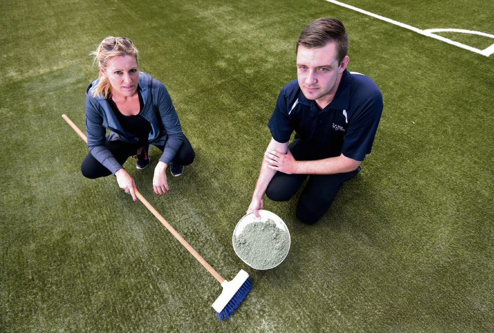 City of Swan Cr Cate McCullough and leisure program supervisor Matt Southern repairing damaged turf at the Ellenbrook Sports Hub. Picture: David Baylis www.communitypix.com.au d466570