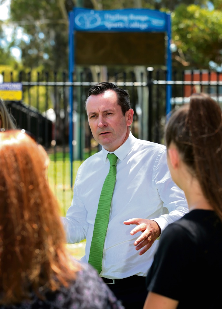 Mark McGowan talks to past students from the Darling Range Sports College in Forrestfield about the promise of funds for much needed upgrades at the college. Picture: David Baylis