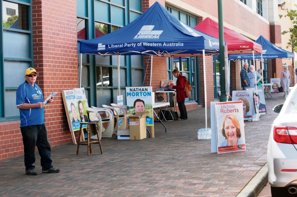 The major parties spruik for their candidates outside the Landgate building in Midland. Picture: Bruce Hunt