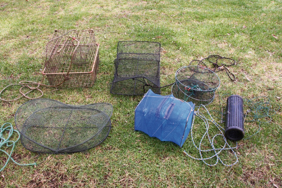 Some of the illegal traps the Armadale Gosnells Landcare Group found in the Canning River.