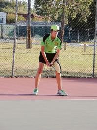 Lochie Mutard hitting the ball.