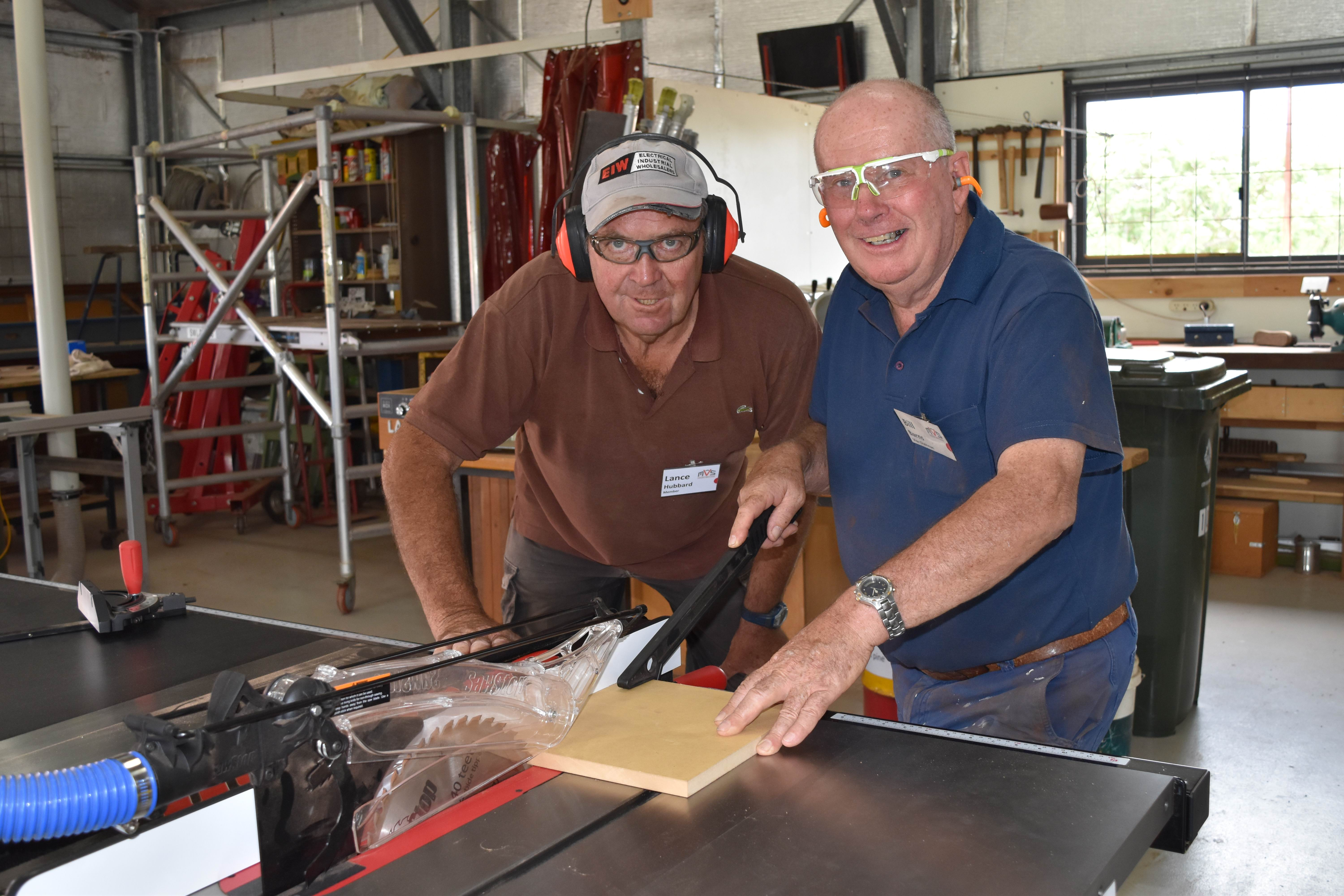 Vincent Men's Shed member Lance Hubbard and vice-chairman Bill Barns with the new safety saw.