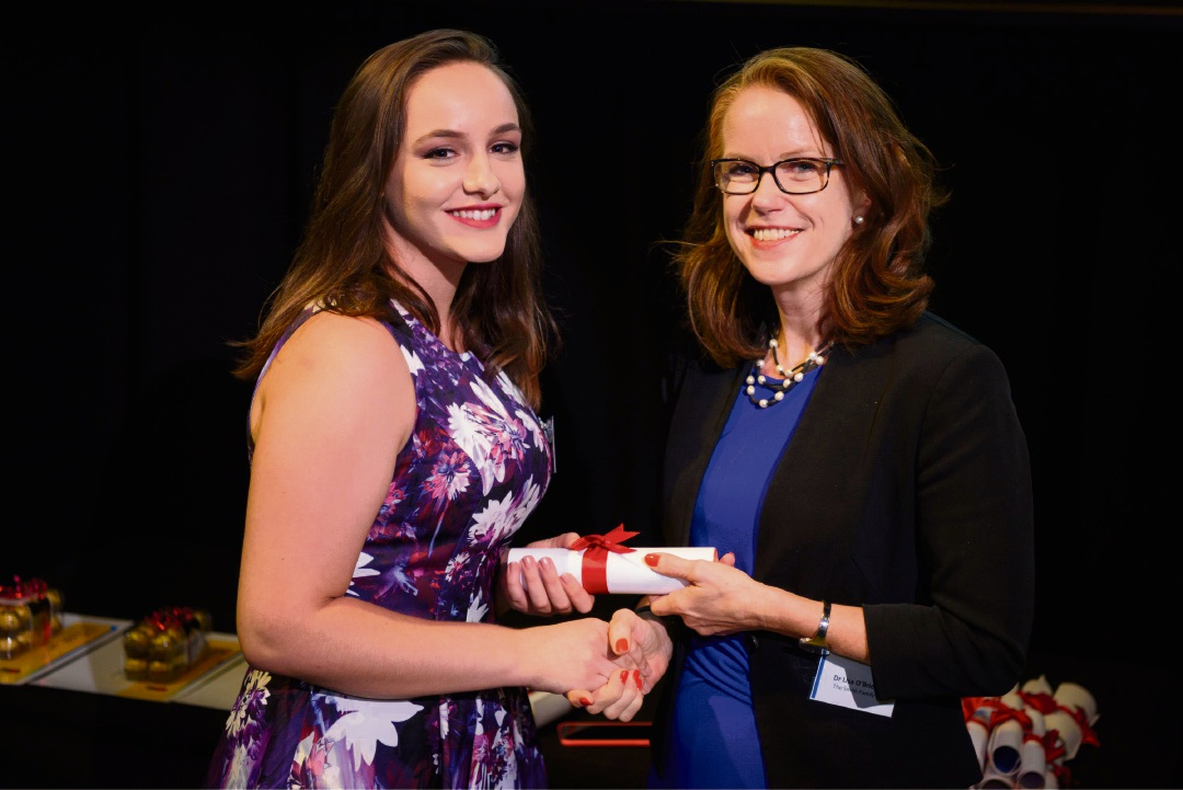 The Smith Family chief executive Lisa O'Brien presents Salina Tairoski with her graduation certificate. Picture: www.romaneye.com