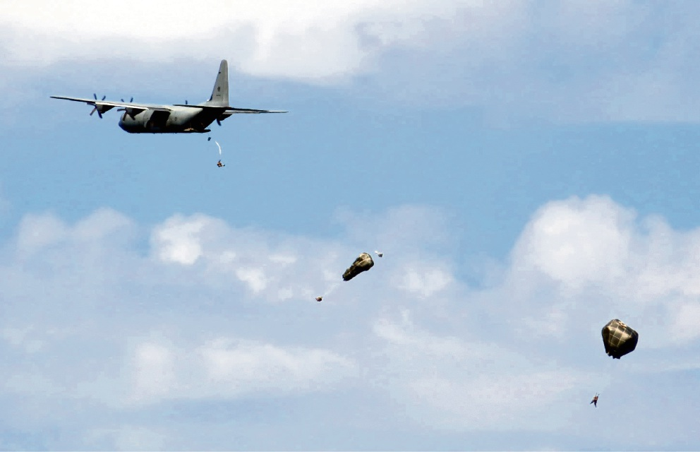 Army personnel parachute off the coast of Iluka. Pictures: Andrew Shaw