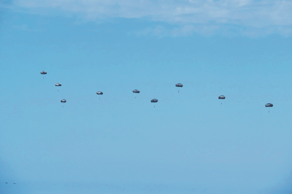 Army personnel parachute off the coast of Iluka. Picture: Andrew Shaw