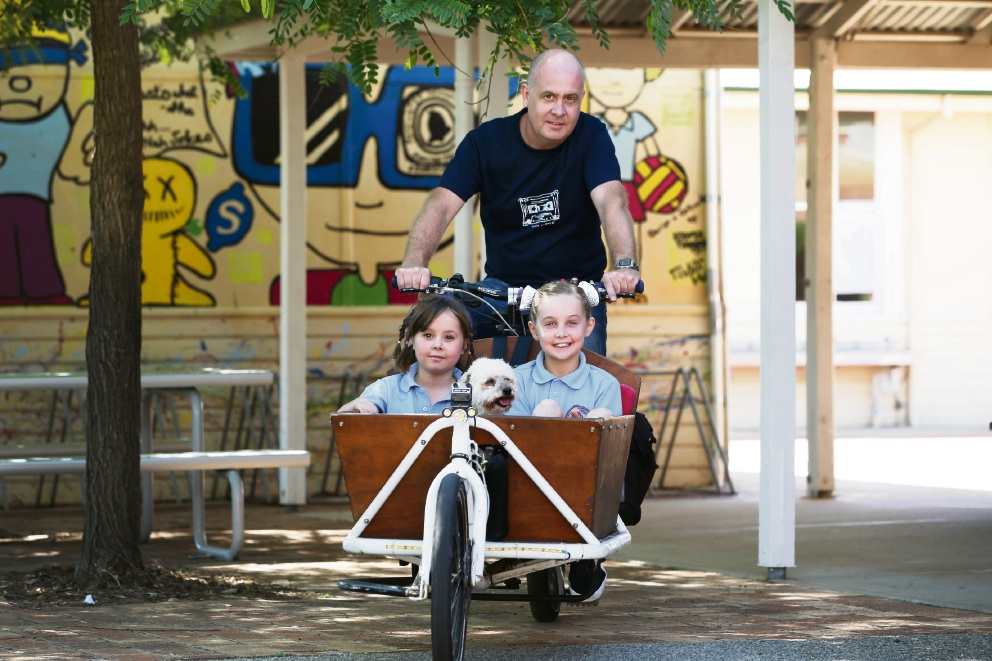 Matt Parks with his daughters Asha  and Zoe  and dog Lulu will celebrate the opening. Picture: Andrew Ritchie        d466797