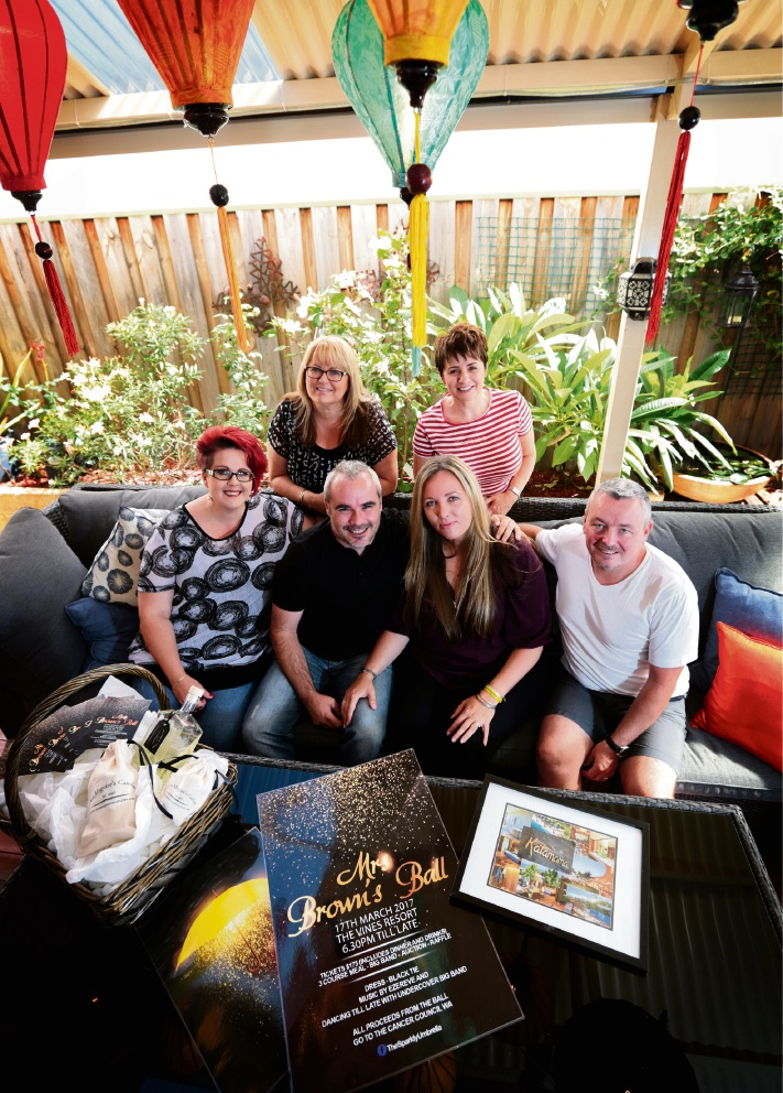 Back left to right: Kelli Francis and Tracey Maguire. Seated from the left: Sharron Attwood, Richard and Kara Nell and Colin Maguire. Picture: David Baylis       d466685