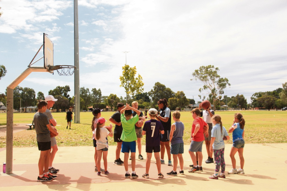WAFC coaches teaching young people from Armadale the finer points of basketball. Picture: Ashleigh Tapper