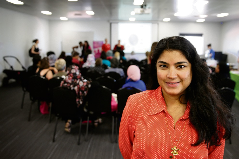 Ishar Multicultural Women's Health Centre chief executive Andrea Creado with women in the background at a Women's Health Forum. Picture: Andrew Ritchie